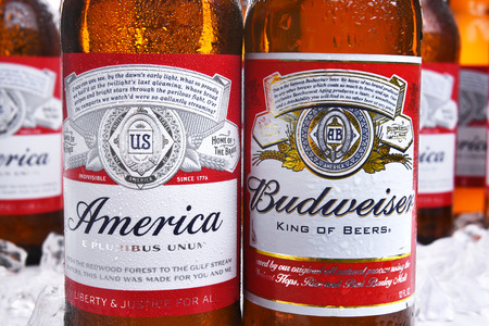 IRVINE, CA - MAY 21, 2016: Two Budweiser Beer Bottles closeup. A limited edition America bottle and a traditional label from Anheuser-Busch. Editöryel