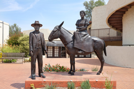 depicts: SCOTTSDALE, ARIZONA - JUNE 10, 2016: Winfield Scott Memorial. The sculpture depicts the founders of Scottsdale, Winfield Scott his mule Old Maud and his wife Helen.