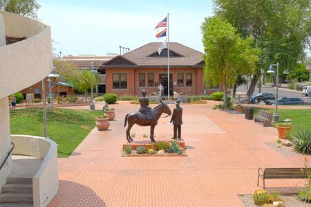 founders: SCOTTSDALE, ARIZONA - JUNE 10, 2016: Winfield Scott Memorial. The sculpture depicting the founders of Scottsdale, with the Historical Museum in the background. Editorial