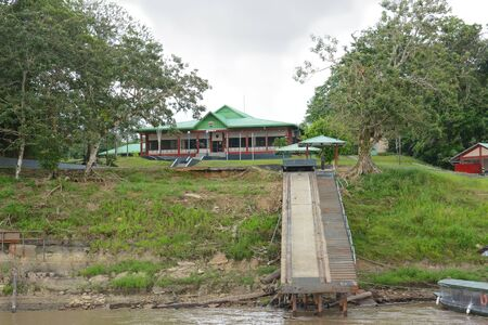 coast guard: IQUITOS, PERU - OCTOBER 12, 2015: Coast Guard School on the Itaya River. Main building and boat launch ramp at the academy in the Peruvian Amazon.