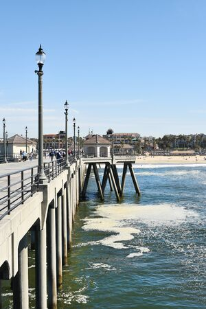 huntington beach: HUNTINGTON BEACH, CA - MARCH 25, 2015: Huntington Beach pier. The pier was built in 1904 and rebuilt after storms in the 1980s. Editorial