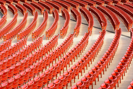 unoccupied: Rows of empty arena seats. Stock Photo