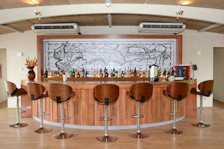 explores: IQUITOS, PERU - OCTOBER 12, 2015: The Amazon Discovery Cruise Ship Bar. The Luxury Ship explores the Peruvian Amazon.