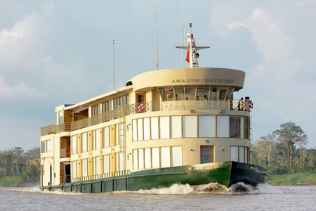 explores: IQUITOS, PERU - OCTOBER 13, 2015: The Amazon Discovery river cruise ship. The luxury boat explores the rainforest and rivers of the Peruvian Amazon. Editorial