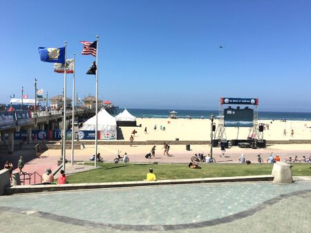 huntington beach: HUNTINGTON BEACH-CALIFORNIA - JULY, 26, 2016: US Open of Surfing at the pier in Huntington Beach, CA. Video displays are set up for fans along the beach front.