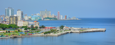 tres: HAVANA, CUBA - JULY 21, 2016: Harbor view with cityscape in the background and Castillo de los Tres Reyes del Morro in the foreground.