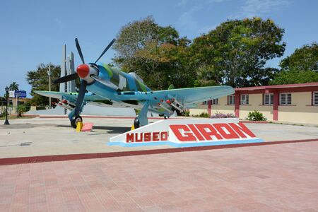 military invasion: PLAYA GIRON, CUBA - JULY 24, 2016: The Bay of Pigs Museum. Vintage plane in front of the museum dedicated to the failed 1961 invasion.
