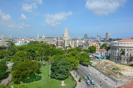 HAVANA, CUBA - JULY 24, 2016: Havana City seen from the Iberostar Parque Central Hotel. In the foreground is Parque Central looking towards the Gran Teatro