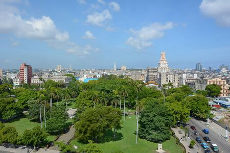HAVANA, CUBA - JULY 24, 2016: Havana City seen from the Iberostar Parque Central Hotel. in the foreground is Parque Central looking towards Gran Teatro. Editorial