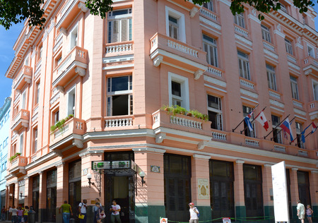 frequented: HAVANA, CUBA - JULY 22, 2016: Hotel Amos Mundos. The hotel frequented by Ernest Hemingway in on a pedestrian street in the heart of Old Havana.