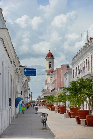 ooking: CIENFUEGOS, CUBA - JULY 24, 2016: Street scene ooking toward Cathedral. The city is noted for iis early 19th century Spanish Enlightenment implementation in urban planning.