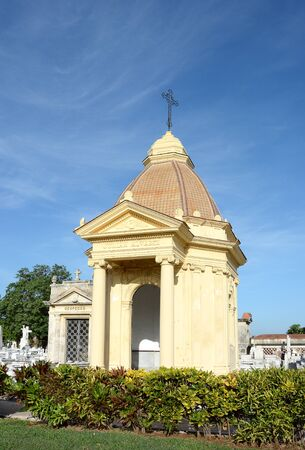 elaborate: HAVANA, CUBA - JULY 22, 2016: Colon Cemetery. One of the many elaborate mausoleums inside the Colon Cemetery, Havana, Cuba