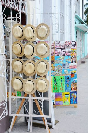 CIENFUEGOS, CUBA - JULY 24, 2016: Souvenir Shop. Panama hats and Che posters on sidewalk displays in the city center of Cienfuegos. Editorial