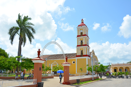 ornately: REMEDIOS, CUBA - JULY 27, 2016: Major Parochial Church of San Juan Bautista in the Isabel II plaza. The church houses 13 ornately decorated altars. Editorial
