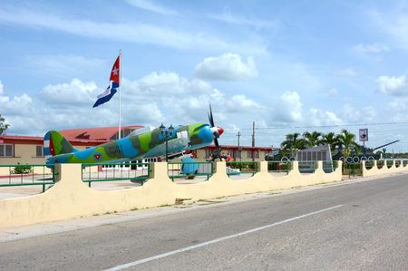 an invasion: PLAYA GIRON, CUBA - JULY 24, 2016: The Bay of Pigs Museum. Vintage plane, tanks and artillery in front of the museum dedicated to the failed 1961 invasion.