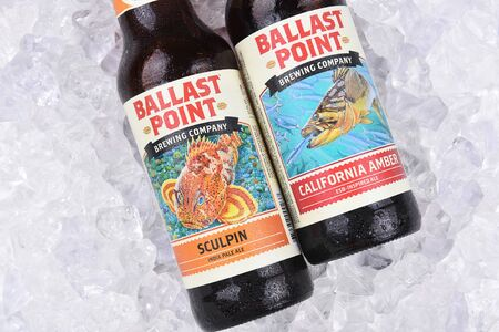 ballast: IRVINE, CALIFORNIA - AUGUST 26, 2016: Two Ballast Point ales on ice. Ballast Point was the first microdistillery in San Diego since Prohibition.