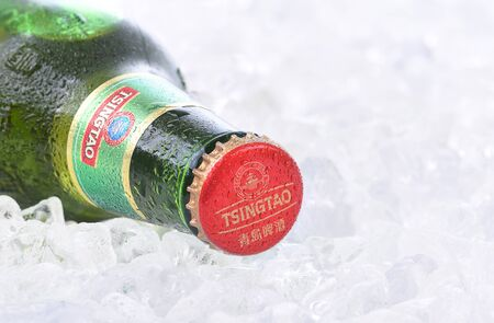 IRVINE, CA - AUGUST 26, 2016: A bottle of Tsingtao Beer. Tsingtao is Chinas second largest brewery, it was founded in 1903 by German settlers.