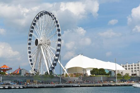 centennial: CHICAGO, ILLINOIS - SEPTEMBER 5, 2016: Centennial Wheel at Navy Pier. The new attraction seen from Lake Michigan.