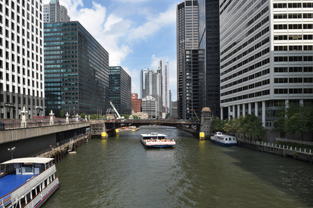 illinois river: CHICAGO, ILLINOIS - SEPTEMBER 5, 2016: Tour Boat Chicago River. Tourists take the tours of the city via the boat to explore its famous architecture.