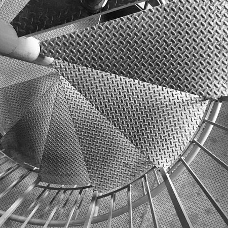 diamondplate: Spiral Stair Detail. Metal dismondplate staircase inside a farm silo.