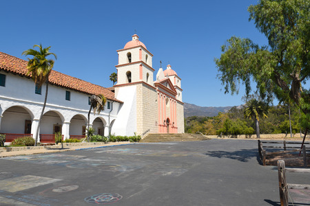 adorn: SANTA BARBARA, CALIFORNIA - SEPTEMBER 21, 2016: Mission Santa Barbara Plaza. Remnants of street paintings adorn the area in front of the mission.