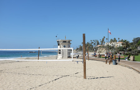 LAGUNA BEACH, CALIFORNIA - OCTOBER 3, 2016: Main Beach. Sand volleyball court, Lifeguard Station and boardwalk are just three of the many attractions along the Laguna Coastline. Editorial
