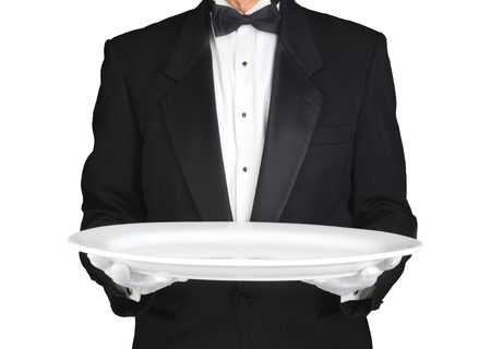 horizontal format: Waiter holding a large white platter over white. Horizontal format, man is unrecognizable. Stock Photo