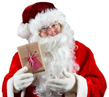 st  nick: Santa Claus holding a plain brown wrapped package. The eco friendly recyclable gift is tied with string and has a blank gift tag. Over White. Stock Photo