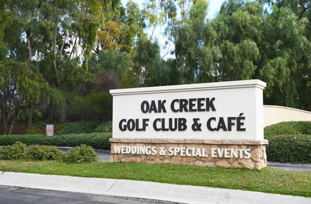 golf of california: IRVINE, CALIFORNIA - JANUARY 1, 2017: Oak Creek Golf Club sign. The Tom Fazio designed course includes a golf school, pro shop, and facilities for events and weddings.