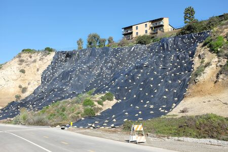 NEWPORT BEACH, CALIFORNIA - JANUARY 16, 2017: Plastic Covered Hillside. Newport Bluffs hillside covered with plastic to prevent erosion. Seen from Back Bay Drive. Editorial