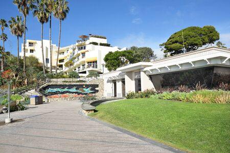 LAGUNA BEACH, CALIFORNIA - JANUARY 6, 2017: Lifeguard Headquarters with the Inn at Laguna Beach on the hillside above.