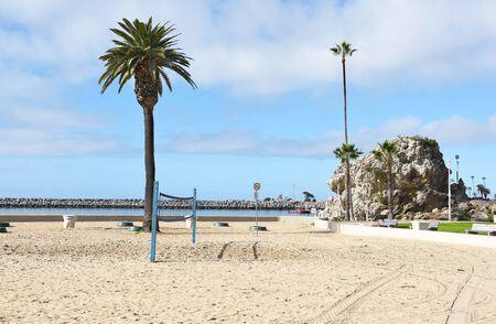 NEWPORT BEACH, CALIFORNIA - JANUARY 6, 2017: Corona del Mar State Beach. Rock Formation at Corona del Mar State Beach, Newport Beach, California, with the jetty in the background.