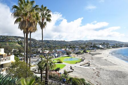 expanse: LAGUNA BEACH, CALIFORNIA - JANUARY 6, 2017: Main Beach from the bluffs. Volleyball courts, basketball courts, and grass expanse line the popular coastline.