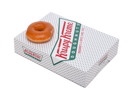 sweet treats: IRVINE, CALIFORNIA - JANUARY 24, 2016:  Krispy Kreme Doughnut Box. Krispy Kreme Doughnuts is a global doughnut company and coffeehouse chain.