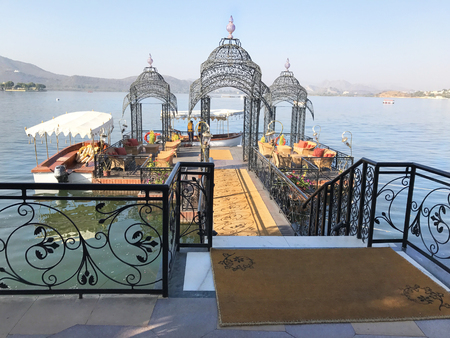 UDAIPUR, INDIA - JANUARY 13, 2017: Ferry Dock at the Taj Lake Palace Hotel on Lake Pichola. The ferry runs to the City Palace.