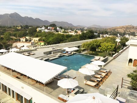 UDAIPUR, INDIA - JANUARY 14, 2017: RAAS Devigarh Hotel pool. Nestled in the Aravalli Hills of the Udaipur area, the 18th century palace, has spectacular views of the valley. Editorial