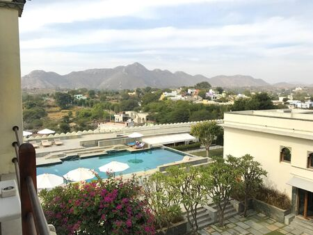 UDAIPUR, INDIA - JANUARY 14, 2017: RAAS Devigarh Hotel pool. Nestled in the Aravalli Hills of the Udaipur area, an 18th century palace, has spectacular views of the valley.
