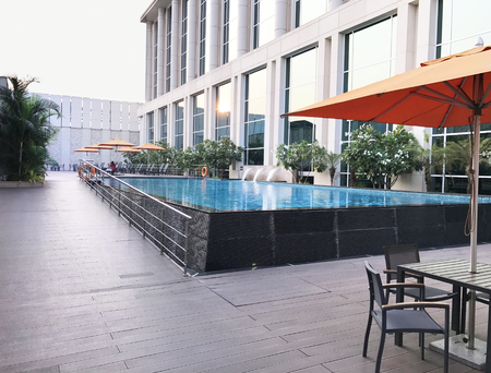 MUMBAI, INDIA - JANUARY 14, 2017: Taj Santacruz Hotel pool. The luxury hotel is near the Chhatrapati Shivaji International Airport. Editorial