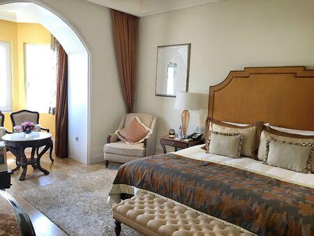 luxury hotel room: MUMBAI, INDIA - JANUARY 11, 2017: Taj Mahal Palace Hotel guest room. The luxury hotel built in 1931 overlooks Mumbai Harbor and the Gateway to India.