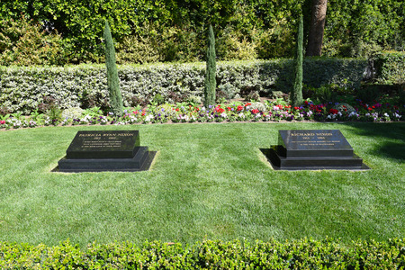 linda: YORBA LINDA, CALIFORNIA - FEBRUARY 24, 2017: President Richard M Nixon and Patricia Ryan Nixon Grave markers. The 37th president and his wife are buried at the Nixon Library and Birthplace.