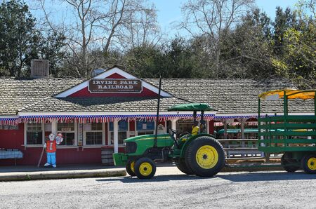 railway transport: ORANGE, CALIFORNIA - FEBRUARY 24, 2017: Irvine Park Railroad and Hay Ride Tractor. The 13 scale train takes adults and children on a scenic ride through the Regional Park. Editorial