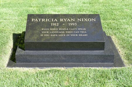 linda: YORBA LINDA, CALIFORNIA - FEBRUARY 24, 2017: Patricia Ryan Nixon wife of President Richard Nixon grave marker. The 37th president and his wife are buried at the Nixon Library and Birthplace.