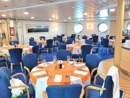 pinta: GALAPAGOS, ECUADOR, FEBRUARY 15, 2017: The La Pinta Yacht Dining Room. The cruise ship offers fine dining and luxury accommodations for its guests.