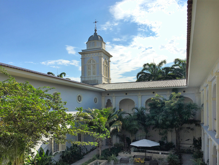 GUAYAQUIL, ECUADOR - FEBRUARY 15, 2017: Hotel del Parque bell tower. Set amidst the exotic greenery of Guayaquil Historical Park, this boutique hotel is in the Samborondon neighborhood.