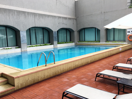 seating area: GUAYAQUIL, ECUADOR - FEBRUARY 15, 2017:  Oro Verde Hotel pool area. The luxury hotel is centrally located in the downtown area within walking distance of many attractions.