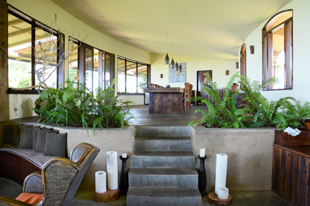 SANTA CRUZ ISLAND, GALAPAGOS - FEBRUARY 20, 2017: Lobby at the Galapagos Safari Camp. The open space lodge is built on a hill with panoramic views from its expansive veranda.