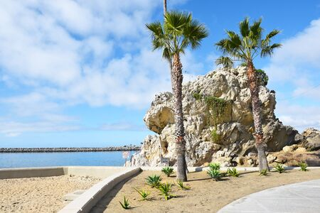 Rock Formation at Corona del Mar State Beach, Newport Beach, California, with the jetty in the background.