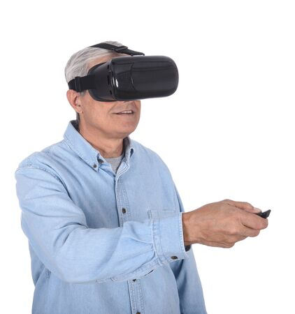 Closeup of a middle aged man experiencing virtual reality goggles for the first time, isolated over white.