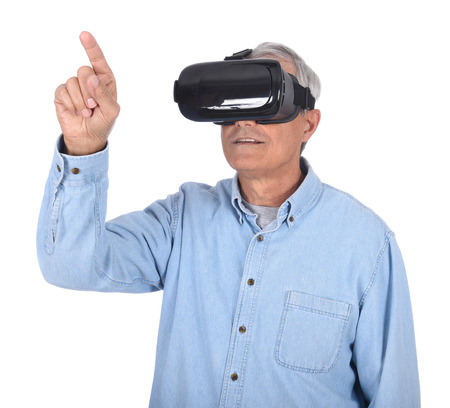 Closeup of a man experiencing virtual reality goggles for the first time, isolated over white.