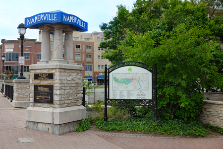 NAPERVILLE, ILLINOIS - MAY 26, 2017: Signs at the entrance to the Naperville Riverwalk along the West Branch of the DuPage River through Naperville, Illinois. Editorial